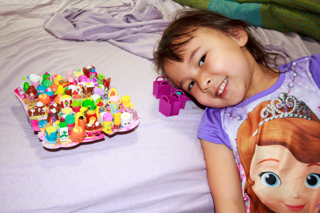 Kayla with her Shopkins.